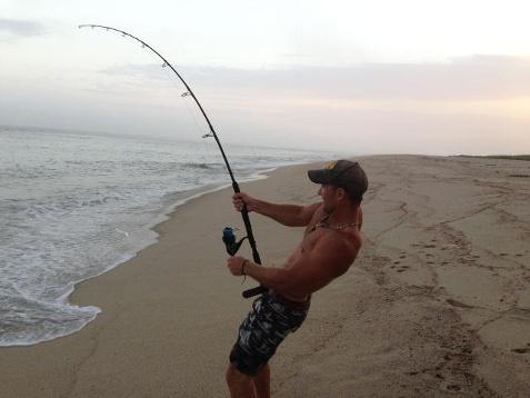 Lottare a mani nude contro uno squalo for Shark fishing pole